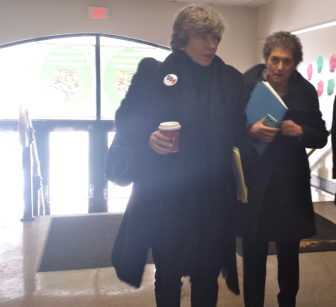 AFT President Randi Weingarten, left, walks into an elementary school in Hartford.
