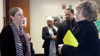 AFT President Randi Weingarten, right, talks with the superintendent of Hartford during a vist to an elementary school in Hartford.