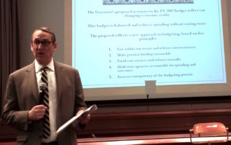 Budget director Benjamin Barnes briefs reporters on the administration's proposed budget.