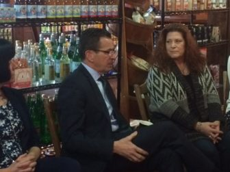 Gov. Dannel P. Malloy and Patti Silva, who fears her daughter could lose state services.