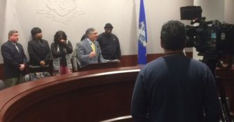 Sen. Len Fasano with relatives of murder victim Jason Smith.