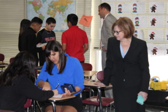 Education Commissioner Dianna Wentzell watches students in a class for English Language Learners at East Hartford Middle School.
