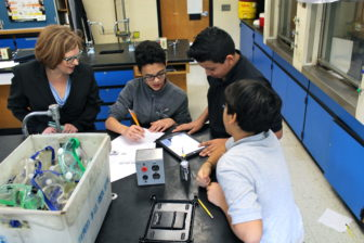 Education Commissioner Dianna Wentzell watches students in a science class at East Hartford Middle School.