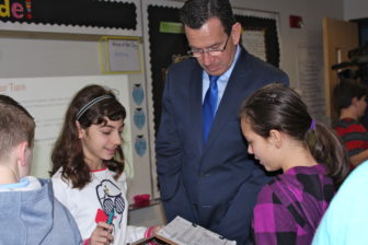 Gov. Malloy works with students on a lesson in a fifth grade class at an elementary school in Cromwell.