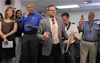SEBAC spokesman Matt O'Connor, center, flanked by jubilant union members after passage of the 2011 concession deal with the state.