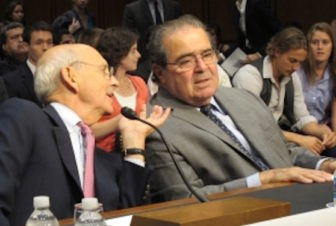Justice Antonin Scalia, right, and Justice Stephen Breyer testify before the Senate Judiciary Committee in 2011.