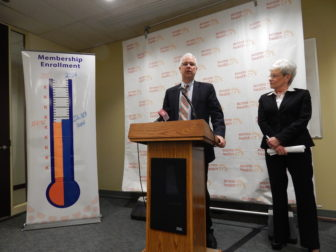 This is a picture of Access Health CEO Jim Wadleigh and Lt. Gov. Nancy Wyman, chairwoman of the exchange's board, at a press conference Monday.