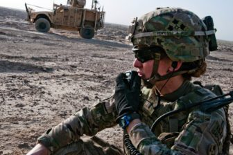 U.S. Army 1st Lt. Elyse Ping Medvigy conducts a call-for-fire during an artillery shoot south of Kandahar Airfield, Afghanistan, in 2014.