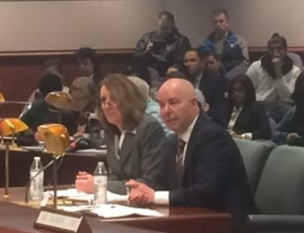 Karen Buffkin and Michael P. Lawlor facing the Judiciary Committee.