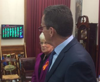 Gov. Dannel P. Malloy watches as the House vote on the deficit-mitigation bill is tallied on the screen.