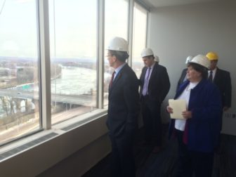The governor checks the view from what will be the office of Kevin Sullivan, commissioner of revenue services.