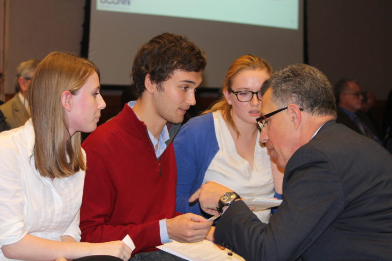 Students at UConn share their concerns about research investments at UConn with the executive vice president for research after a recent Board of Trustees meeting