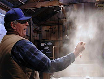 Ron Wenzel of the Wenzel Sugarhouse in Hebron tests the maple sap as it concentrates into syrup.