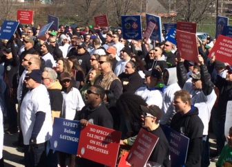 State employees rally outside the Capitol to protest threatened layoffs and requests for givebacks.
