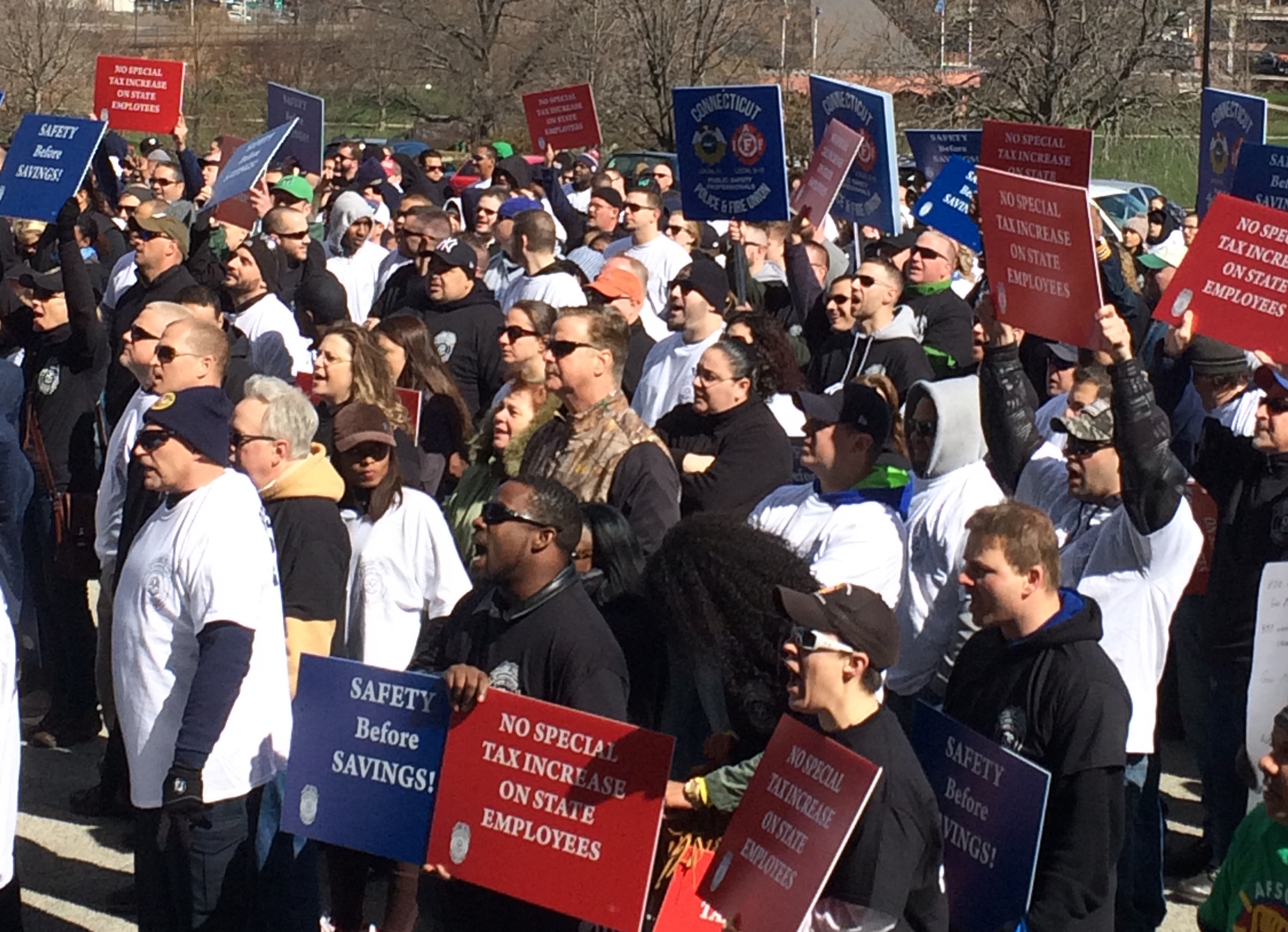 Hundreds of state employees demand no layoffs or concessions
