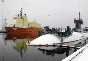 The Los Angeles-class fast attack submarine USS Alexandria (SSN 757) and the Submarine Support Vessel (SSV) Carolyn Chouest sit covered in snow on a blustery, snowy day at Naval Submarine Base New London in Groton.