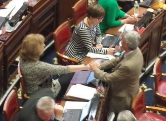 Rep. Cecilia Buck-Taylor, left, is consoled by a colleague after sharing her story.