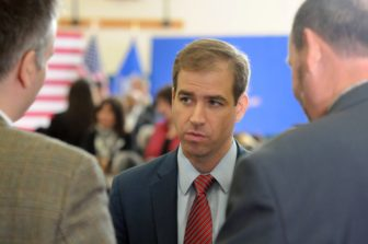 Hartford Mayor Luke Bronin answers questions from the press at Hillary Clinton's campaign forum on gun violence at the Wilson-Gray YMCA Thursday