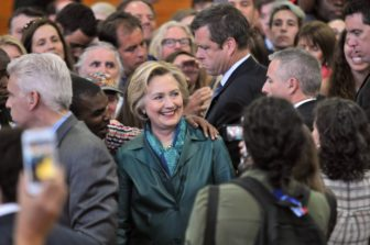 Democratic presidential candidate Hillary Clinton poses for a picture with a supporter after her rally at the University of Bridgeport on Sunday.