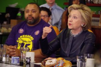 Presidential hopeful hillary Clinton speaks with a small crowd at Orangeade, a New Haven restaurant Saturday. At left is Terrell Williams, a New Haven native who works as a certified nursing and patient care assistant.