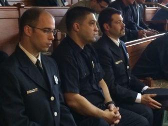 Three members of Uniformed Professional Fire Fighters of Connecticut listen to the debate in the Senate.