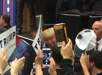 Donald J. Trump presses the fleshes, signs autographs.