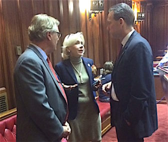 Sen. Paul Formica, Rep. Lonnie Reed and Sen. Paul Doyle confer after their nuclear energy bill passed the Senate.