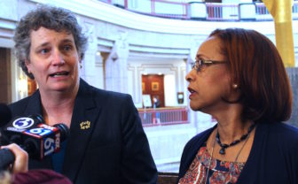 Sen. Beth Bye of West Hartford, left, and Rep. Toni Walker of New Haven, co-chairs of the legislature's Appropriations Committee, discuss the committee's budget proposal with reporters.