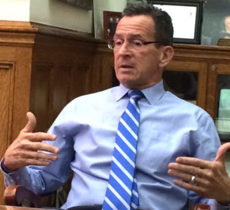 Gov. Dannel P. Malloy assesses the state if budget negotiations for reporters Friday night.