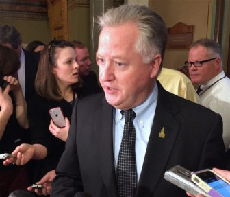 House Speaker J. Brendan Sharkey talks to reporters Tuesday.