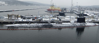 An aerial view of attack submarines USS Virginia, bottom, and USS Connecticut at the Groton submarine base in 2007.