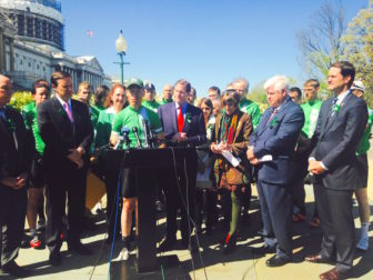 "Monte Frank, leader of the ""Team26"" cyclists who arrived in Washington from Newtown Tuesday, is surrounded by members of the Connecticut congressional delegation and his fellow riders as he advocates for federal action on gun control."