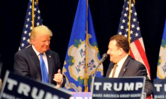 Republican presidential candidate Donald Trump invites Rep. Tony D'Amelio, R-Waterbury, onto the stage with him at Crosby High School in Waterbury on Saturday.