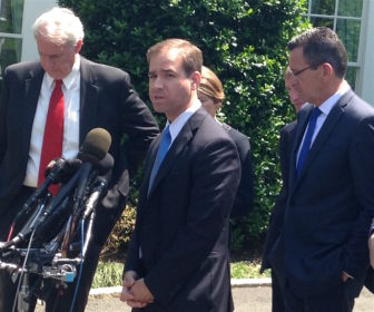 Hartford Mayor Luke Bronin, at microphone, and Gov. Dannel P. Malloy at the White House Tuesday.