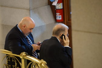It was a night of phone calls and text messages for Sen. Martin M. Looney and his chief of staff, Vinnie Mauro.