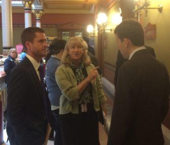 Paddi LeShane, center, lobbying Rep. Matt Lesser to vote against a nuclear-energy bill.