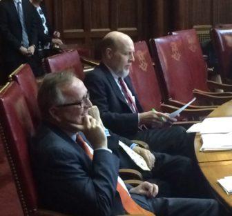 Sen. Andrew Maynard, left, listening to tributes Wednesday.