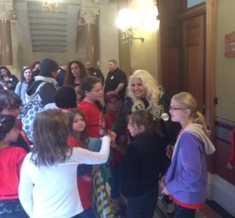 """Beth Chapman, who starred with her husband, Dog the Bounty Hunter,"""" in a reality TV show, greeted visiting school kids at the Capitol. She was lobbying against bail reform."""