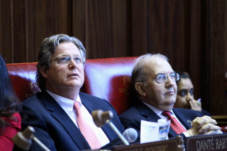 Sen. Ted Kennedy Jr. (left) and Senate President Pro Tem Martin Looney watch the vote board overhead.