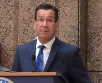 Gov. Malloy answers questions after a meeting of the State Bond Commission Friday.