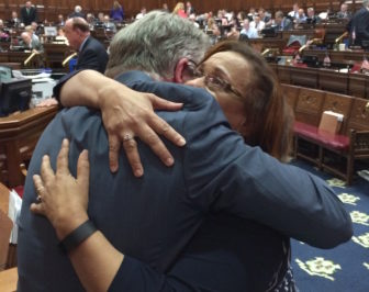 House Speaker J. Brendan Sharkey hugs Rep. Toni Walker, co-chair of the Appropriations Committee, after final passage of the state budget in the House.