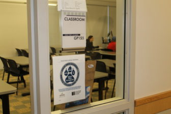 Hundreds of high school students participate in dual-enrollment college programs around the state. This one, in Manchester at Great Path Academy, is not among those approved for the new federal money for low-income students.