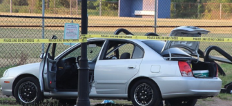 A car in which two victims were found, one of whom died.