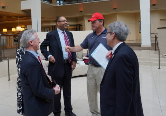 August Wolf, in a red cap inspired by Donald J. Trump, sought signatures from diners at the Prescott Bush dinner last month.