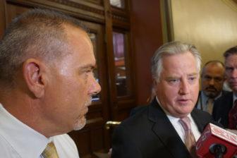 House Speaker J. Brendan Sharkey, right, and House Majority Leader Joe Aresimowicz talk to reporters Thursday.