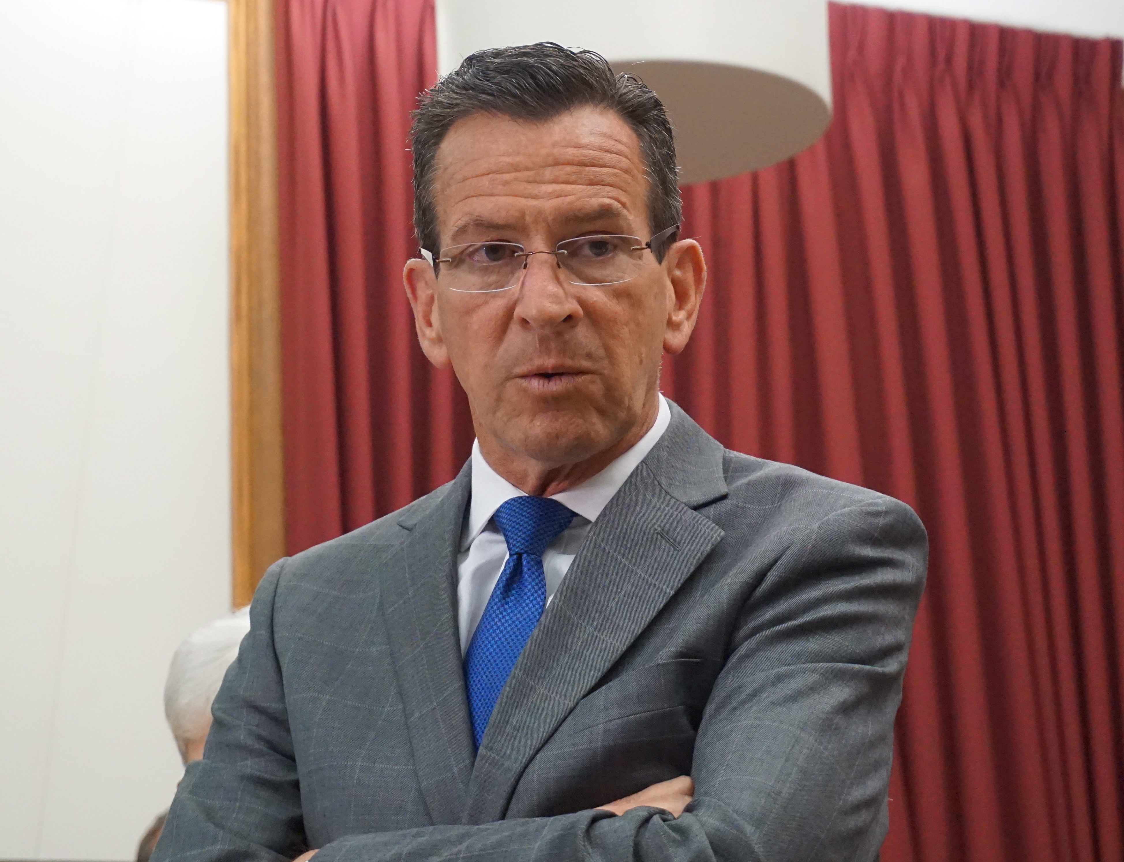 Malloy signs CT budget but trims town aid to offset prison costs