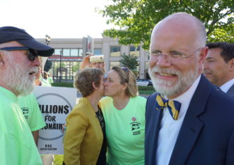 Comptroller Kevin Lembo mingled outside. His aide, Martha Carlson, kisses Lori Pelletier, the AFL-CIO president.
