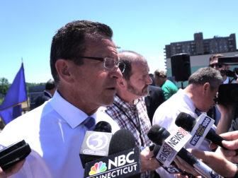 Gov. Dannel P. Malloy talks to reporters.
