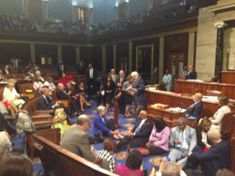 Rep. John Larson at the podium amidst fellow Democrats during the sit-in.