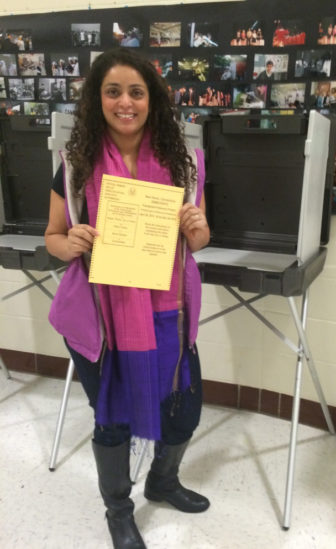 One new American and new voter, Sahar Usmani-Brown, with her ballot in New Haven on April 26